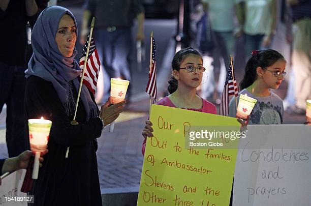 A vigil was held in Harvard Square this evening for the US ambassador to Libya and the other victims of the attack in Benghazi Pictured left to right...