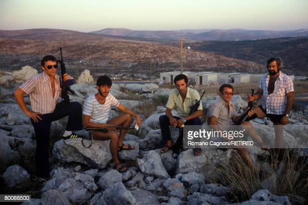 Vigilantes stand guard at sunset in the Israeli Ariel settlement in the West Bank circa 1980