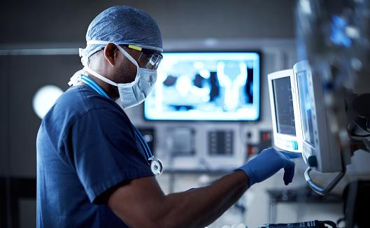 Vigilantly monitoring his patient's vitals 592647720