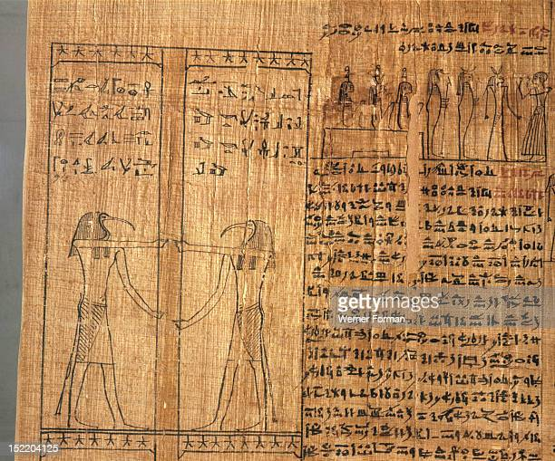 A vignette from the Book of the Dead of Kahapa On the left is Thoth in his Ibis headed aspect Above are hieroglyphs The text on the right is written...