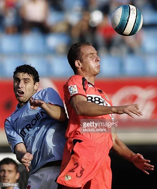 Celta Vigo's Antonio Nunez jumps for the ball with Sevilla FC's Kepa Blanco during their Spanish first League football match at the Balaidos Stadium...