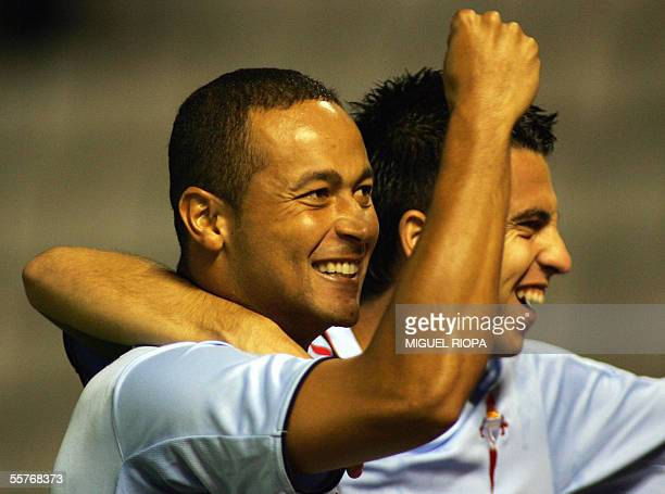 Celta Vigo's brazilian Joao Baiano celebrates with teammate Jorge Larena after scoring the first goal against Sevilla FC during their spanish first...