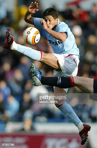 Celta Vigo's Uruguayan Fabian Canobbio kicks the ball during the match against Osasuna during their Spanish first league football match at Balaidos...