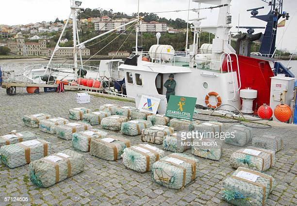 Containing cocaine are displayed 18 March 2006 after some 800 kilos of the drug were seized and 15 others arrested during an operation targetting an...