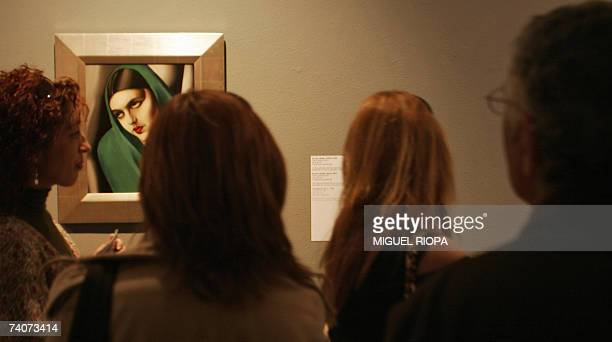 Visitors admire a painting of Tamara de Lempicka during an exhibition 04 May 2007 in Vigo Lempicka Born in 1898 to a Polish mother and a wealthy...