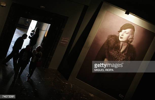 Visitors looks at a portrait of the painter Tamara de Lempicka during an exhibition 04 May 2007 in Vigo Lempicka captured the essence of modernism...