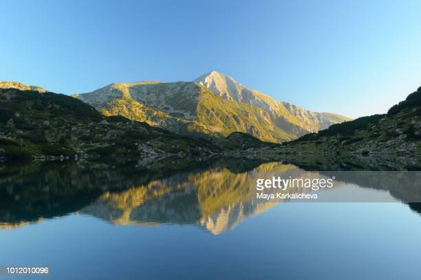 vihren peak reflection on glacial lake, pirin mountain, bulgaria - pirin mountains stock pictures, royalty-free photos & images
