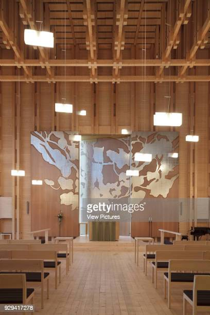 Viikki Church Helsinki Finland Architect JKMM Architects 2005 Interior in spruce with aisle flanked by pews leading to Elaman puu altarpiece in...