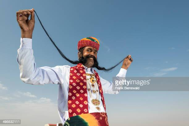 Vijai Kumar Modi a Rajput proudly presents his 150 meter long black moustache