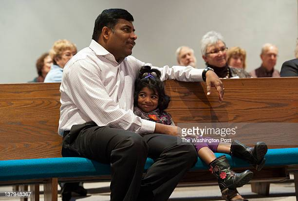 Vijay Allan with his daughter Sophia Allen worshipping at Peace Lutheran Church in Alexandria Virginia on January 22 2012 Peace Lutheran is one of...