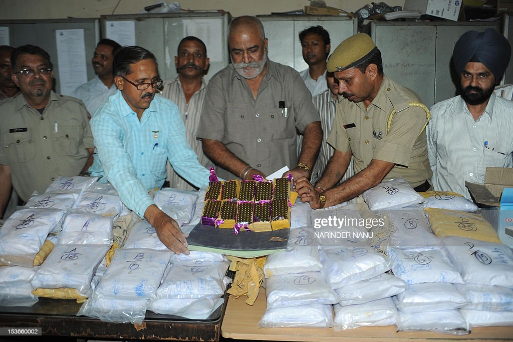Vijay Bahadur Singh Deputy Commissioner Railway Cargo Customs along with other officials pose with some 101 packets of heroin said to have been...