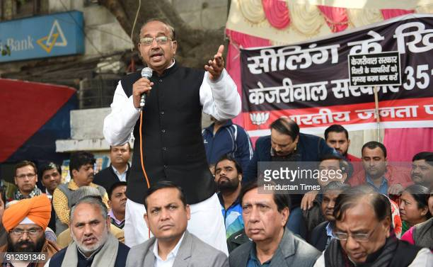 Vijay Goel BJP politician demonstrates during a protest against ongoing sealing drive at Bara Tooti Chowk Sadar Bazaar on January 31 2018 in New...