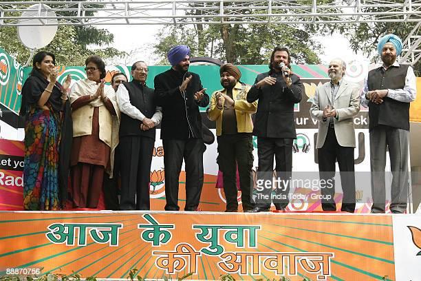 Vijay Kumar Malhotra BJP Leader and MP from South Delhi along with Navjot Singh Sidhu Former Indian Cricket Player and BJP MP Daler Mehndi Punjabi...