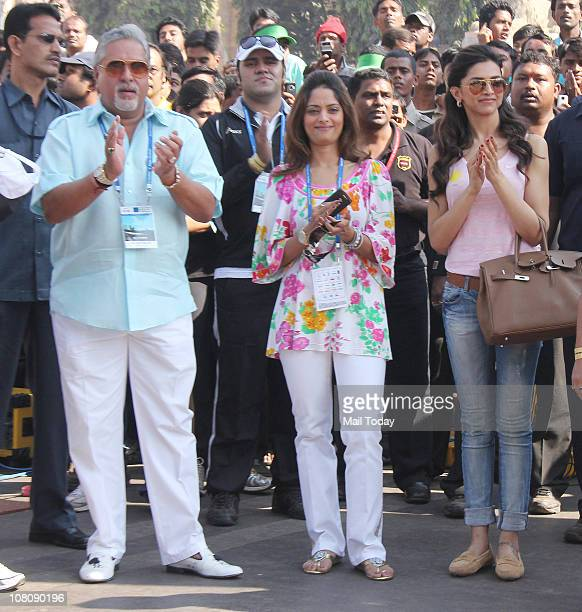 Vijay Mallya and Deepika Padukone during the Standard Chartered Mumbai Marathon 2011 race in Mumbai on January 16 2011