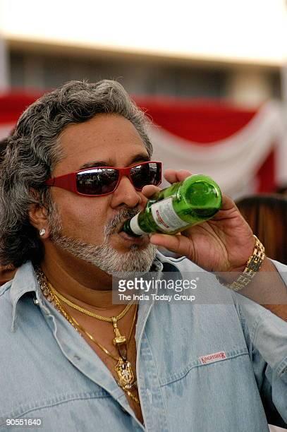 Vijay Mallya Chairman United Breweries group and MP drinks Kingfisher Beer in Mumbai India on 18th January 2006 Potrait drinking