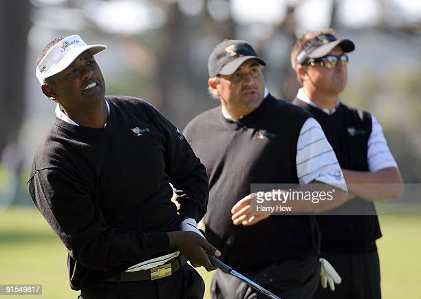Vijay Singh, Angel Cabrera and Robert Allenby of the International Team watch a shot during a practice round prior to the start of The Presidents Cup...