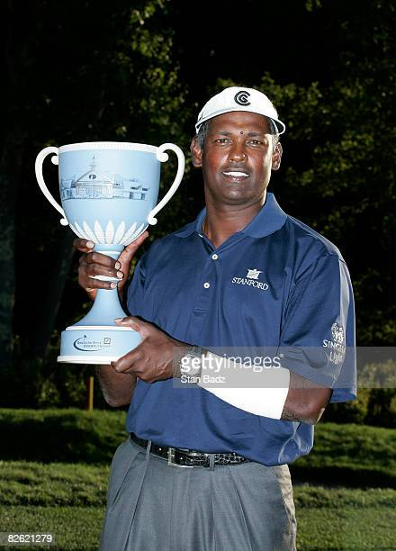 Vijay Singh holds the winner's trophy after the final round of the Deutsche Bank Championship held at TPC Boston on September 1, 2008 in Norton,...