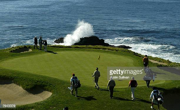 Vijay Singh of Fiji and Phil Mickelson walk on to the seventh green with their playing partners at Pebble Beach Golf Links during the ATT Pebble...