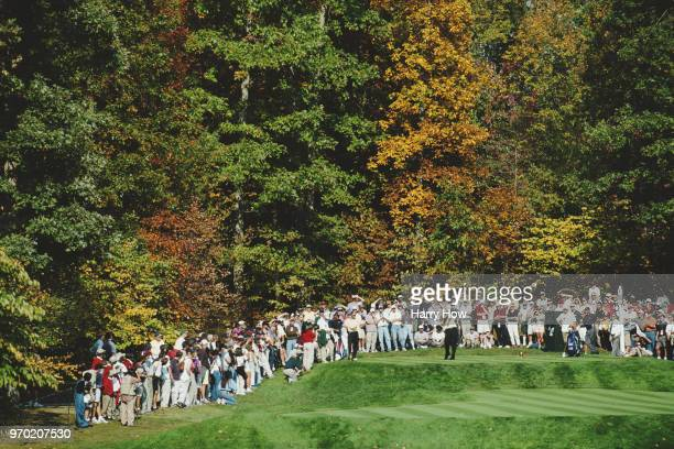 Vijay Singh of Fiji ands the International Team drives off the tee in front of the watching spectators during the 4th Presidents Cup golf tournament...