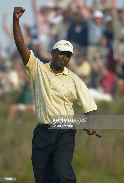 Vijay Singh of Fiji celebrates the winning putt in his match against Tiger Woods and Charles Howell III of USA during the second round of fourballs...