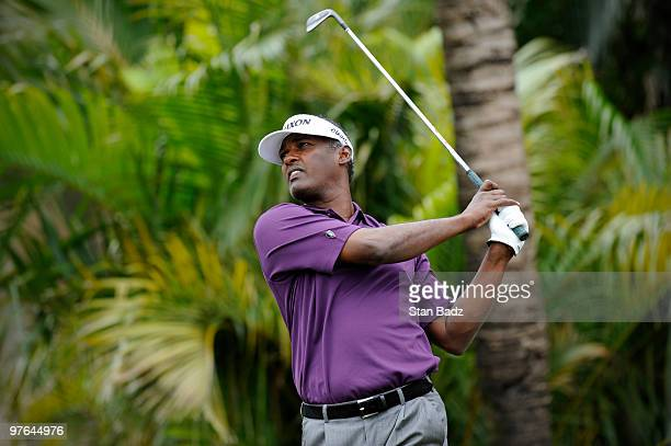 Vijay Singh of Fiji hits shots on the practice range during the first round of the World Golf ChampionshipsCA Championship at Doral Golf Resort and...