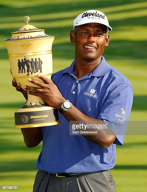 Vijay Singh of Fiji holds the Gary Player trophy after winning the WGC-Bridgestone Invitational at Firestone Country Club South Course on August 3,...