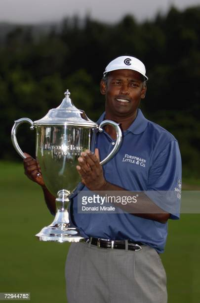Vijay Singh of Fiji holds the winner's trophy after his 14-under victory during the final round of the Mercedes-Benz Championships on January 7, 2006...