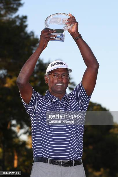 Vijay Singh of Fiji Islands celebrates with the trophy after winning the Charles Schwab Cup Championship at Phoenix Country Club on November 11 2018...