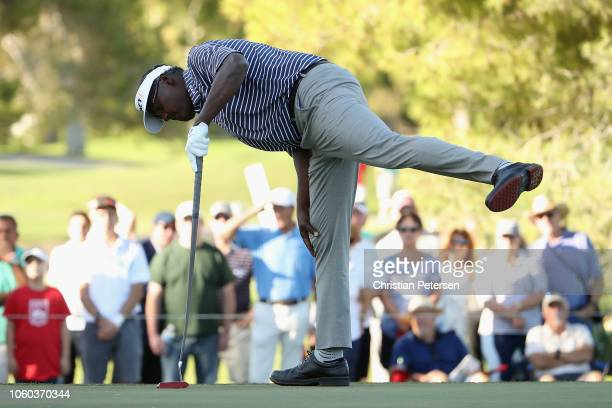 Vijay Singh of Fiji Islands reacts to a birdie putt on the 16th green during the final round of the Charles Schwab Cup Championship at Phoenix...