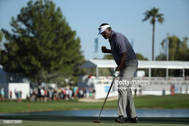 Vijay Singh of Fiji Islands reacts to a birdie putt on the 17th green during the final round of the Charles Schwab Cup Championship at Phoenix...