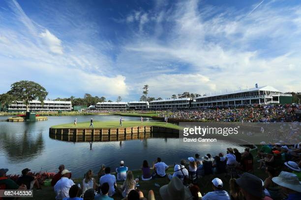Vijay Singh of Fiji just misses a birdie putt on the par 3 17th hole during the second round of THE PLAYERS Championship on the Stadium Course at TPC...
