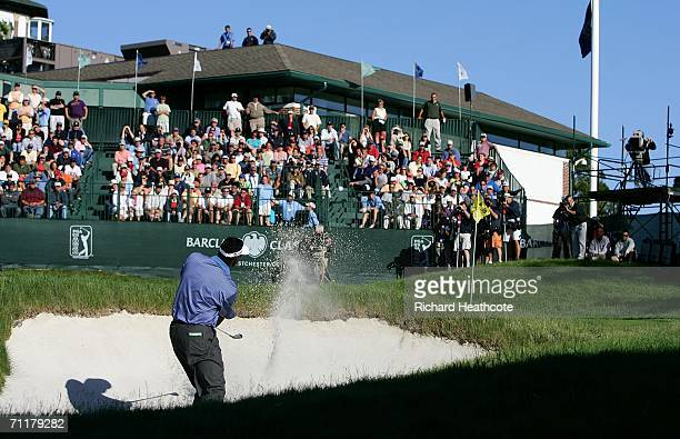 Vijay Singh of Fiji plays from a greenside bunker on the 18th hole during the final round of the Barclays Classic at the Westchester Country Club on...