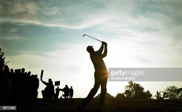 Vijay Singh of Fiji plays his iron shot on the first fairway during his semi-final match against South Africa's Ernie Els in The World Match Play...