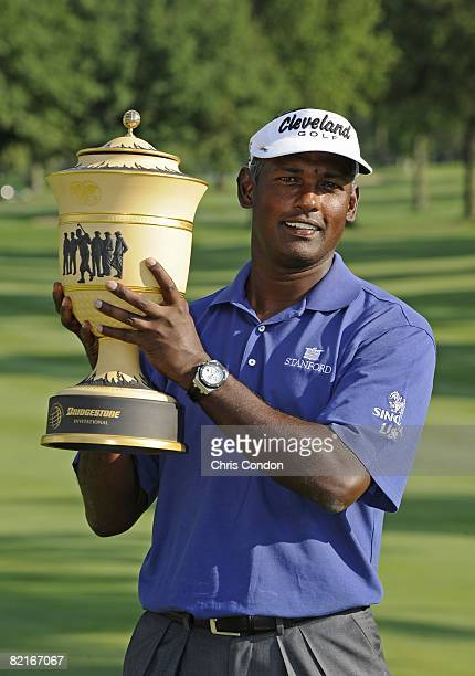 Vijay Singh of Fiji poses with the Gary Player Cup after winning the World Golf Championships-Bridgestone Invitational held on the South Course at...