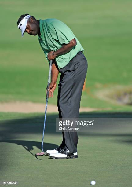Vijay Singh of Fiji putts for birdie during the first round of the Sony Open in Hawaii held at Waialae Country Club on January 14 2010 in Honolulu...
