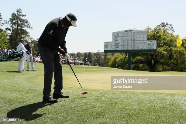 Vijay Singh of Fiji putts on the 18th green during the first round of the 2018 Masters Tournament at Augusta National Golf Club on April 5 2018 in...