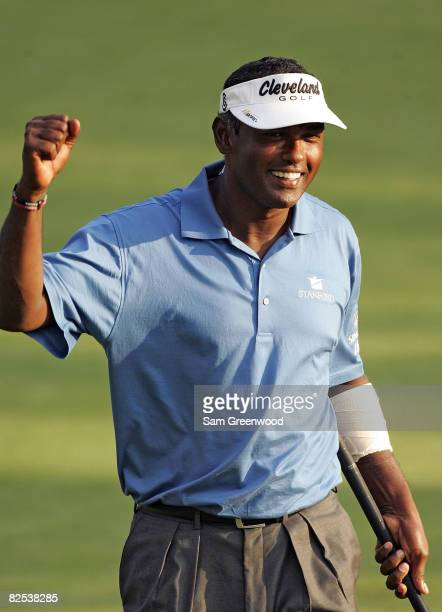 Vijay Singh of Fiji reacts to a birdie putt on the first playoff hole after the final round of The Barclays at Ridgewood Country Club on August 24...