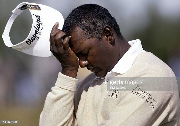 Vijay Singh of Fiji rests for a moment at the 15th tee during the first round of the 86th PGA Championship at Whistling Straits Golf Course 12...