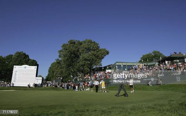 Vijay Singh of Fiji sinks the winning putt during the final round of the Barclays Classic at the Westchester Country Club on June 11 2006 in Harrison...