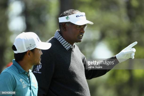 Vijay Singh of Fiji talks with Satoshi Kodaira of Japan on the 18th hole during the first round of the 2018 Masters Tournament at Augusta National...