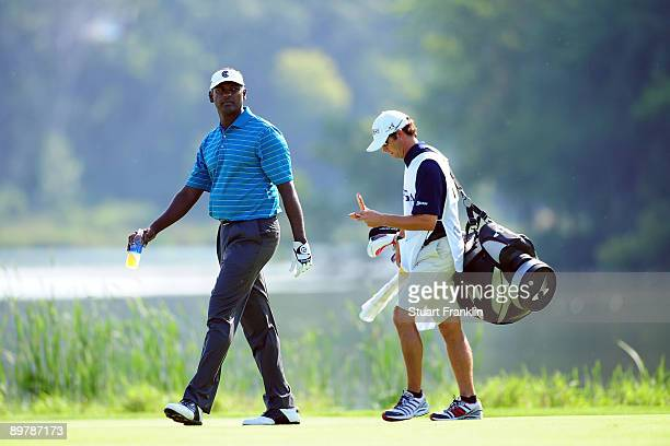 Vijay Singh of Fiji walks with his caddie Chad Reynolds on the 16th hole during the second round of the 91st PGA Championship at Hazeltine National...
