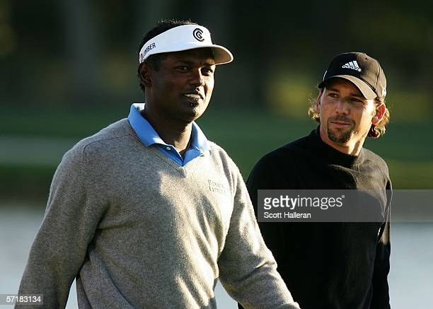 Vijay Singh of Fiji walks with Sergio Garcia of Spain off the 18th tee during the third round of The Players Championships on the Stadium Course at...