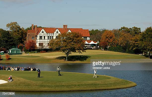 Vijay Singh of Fiji watches as Adam Scott of Australia putts on the sixth hole during the final round of the PGA Tour Championship at East Lake Golf...