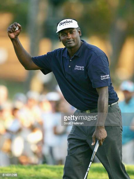 Vijay Singh of Fiji waves to the gallery after a birdie on the 18th green on the Copperhead Course at the Innisbrook Resort during the final round of...
