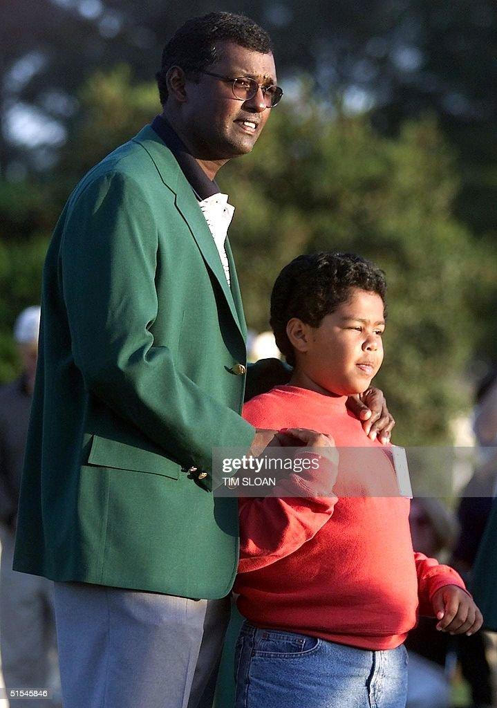 Vijay Singh of Fiji wears his green jacket with his son Qass
