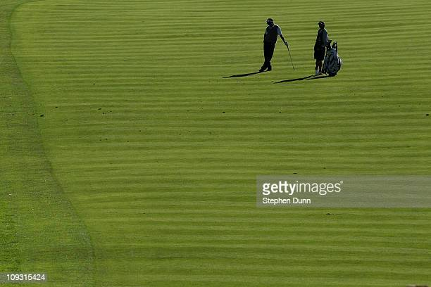Vijay Singh of the Figi Islands waits to hit his second shot on the 18th hole during the final round of the Northern Trust Open at Riviera Country...