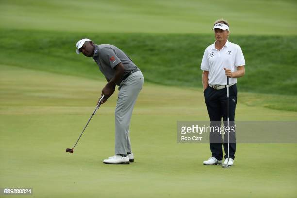 Vijay Singh putts as Bernhard Langer looks on during the final round of the Senior PGA Championship at Trump National Golf Club on May 28 2017 in...