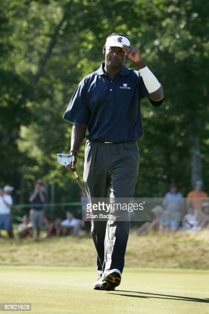 Vijay Singh tips his brim after making his putt at the 13th green during the final round of the Deutsche Bank Championship held at TPC Boston on...