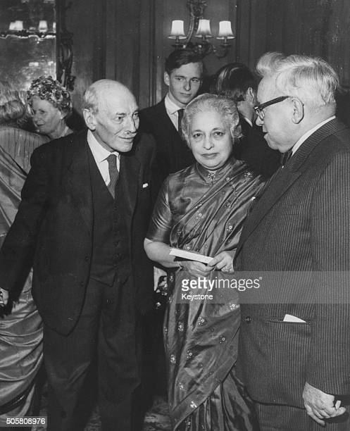 Vijaya Lakshmi Pandit retiring Indian High Commissioner to London talking to former Prime Minister Clement Attlee and Lord Morrison of Lambeth at a...