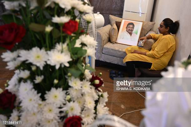 Vijayalakshmi daughter of Ceylon Workers' Congress trade union leader Arumugam Thondaman sits next to a portrait of her father during the funeral in...
